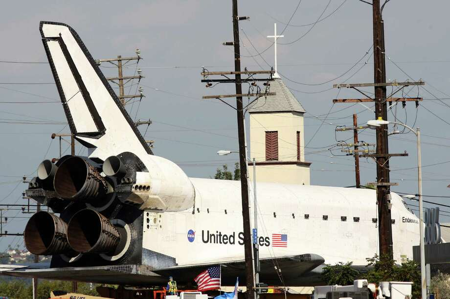 The space shuttle Endeavour is transported to the California Science Center in Exposition Park from Los Angeles International Airport. Photo: David McNew / Getty Images