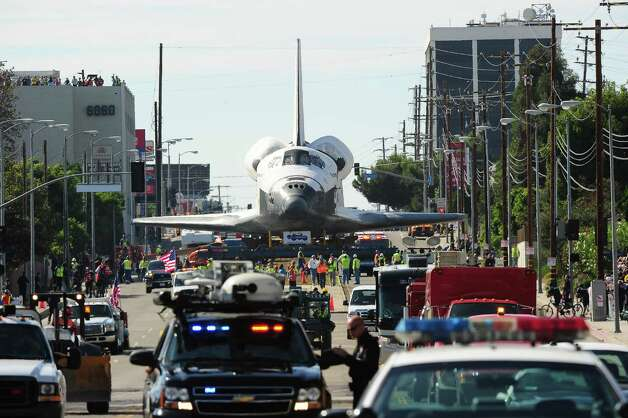The Space Shuttle Endeavour is transported through the streets of Los Angeles. Photo: Robyn Beck / AFP/Getty Images