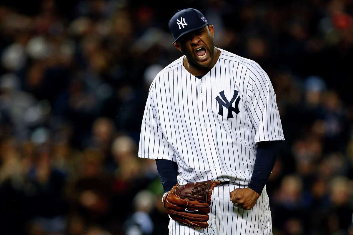 NEW YORK, NY - OCTOBER 12: CC Sabathia #52 of the New York Yankees reacts after getting out of the eighth inning against the Baltimore Orioles during Game Five of the American League Division Series at Yankee Stadium on October 12, 2012 in New York, New York.