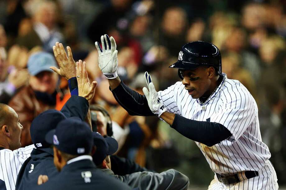 NEW YORK, NY - OCTOBER 12:  Curtis Granderson #14 of the New York Yankees celebrates after hitting a solo home run in the seventh inning against the Baltimore Orioles during Game Five of the American League Division Series at Yankee Stadium on October 12, 2012 in New York, New York. Photo: Elsa, Getty Images / 2012 Getty Images