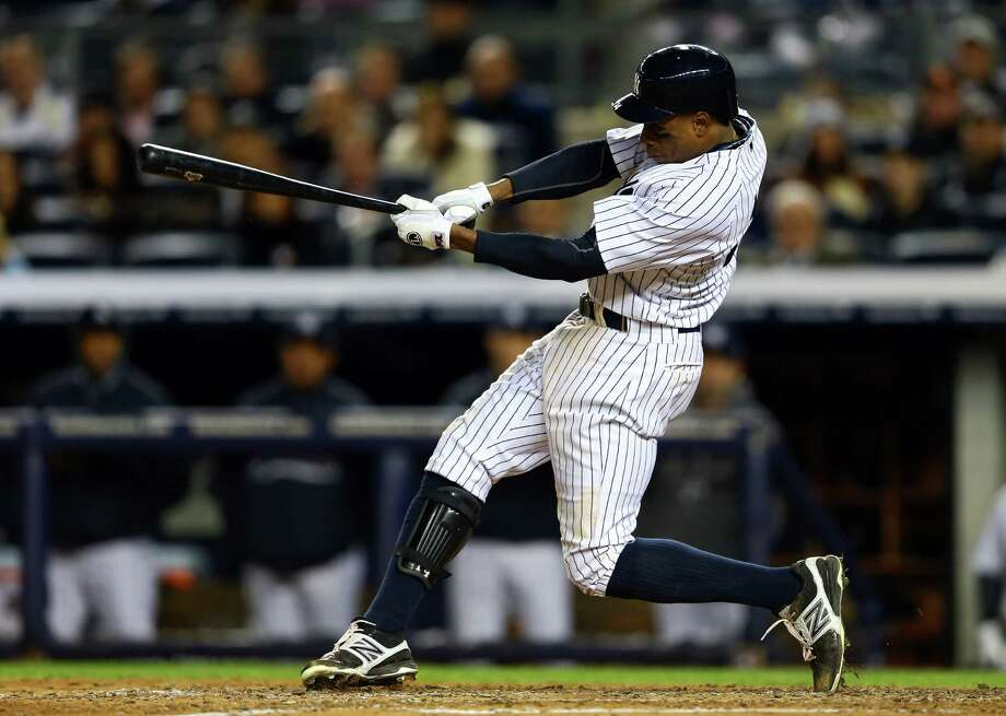 NEW YORK, NY - OCTOBER 12:  Curtis Granderson #14 of the New York Yankees hits a solo home run in the seventh inning against the Baltimore Orioles during Game Five of the American League Division Series at Yankee Stadium on October 12, 2012 in New York, New York. Photo: Al Bello, Getty Images / 2012 Getty Images