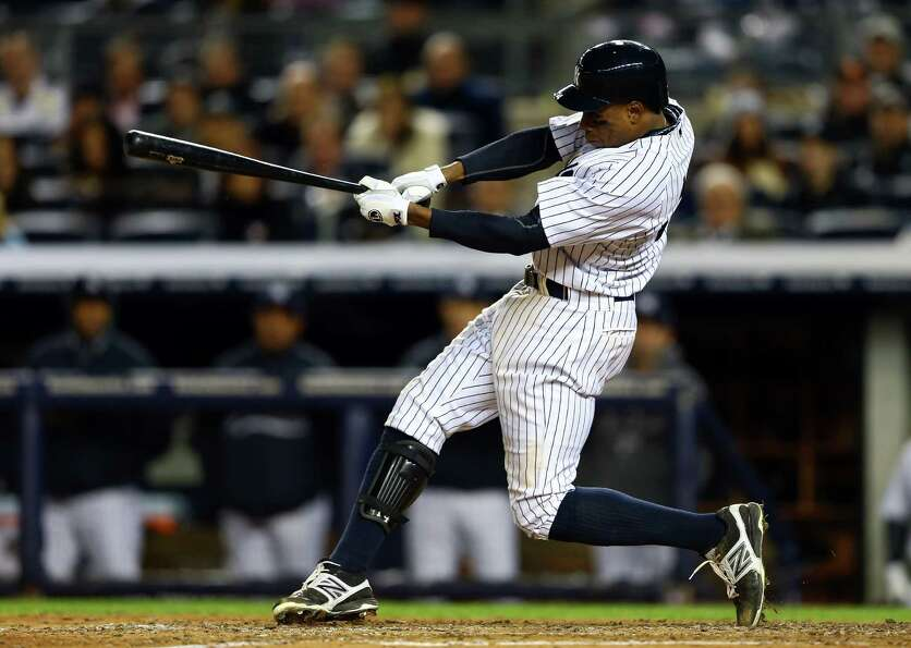 NEW YORK, NY - OCTOBER 12:  Curtis Granderson #14 of the New York Yankees hits a solo home run in th