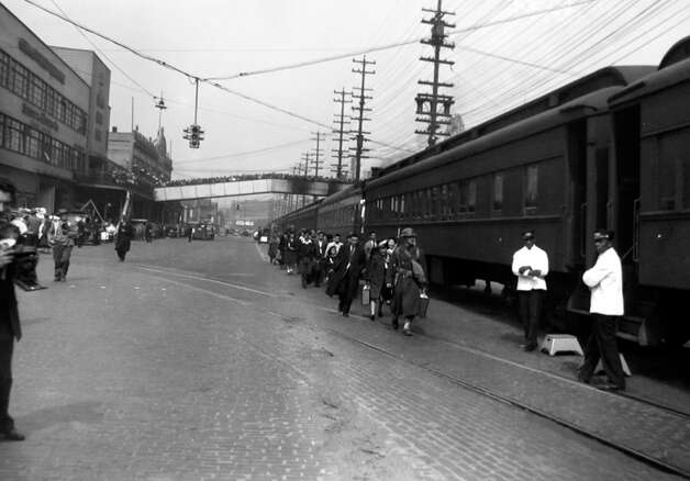 The internment of 227 Japanese Americans - forced to leave Bainbridge Island and board a train in Seattle to the Manzanar camp in California - is pictured in 1942. Photo: MOHAI/seattlepi.com File,  -
