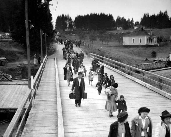 Japanese Americans leave their homes on Bainbridge Island on March 30, 1942, after President Franklin Roosevelt signed Executive Order 9066. Photo: MOHAI/seattlepi.com File,  -