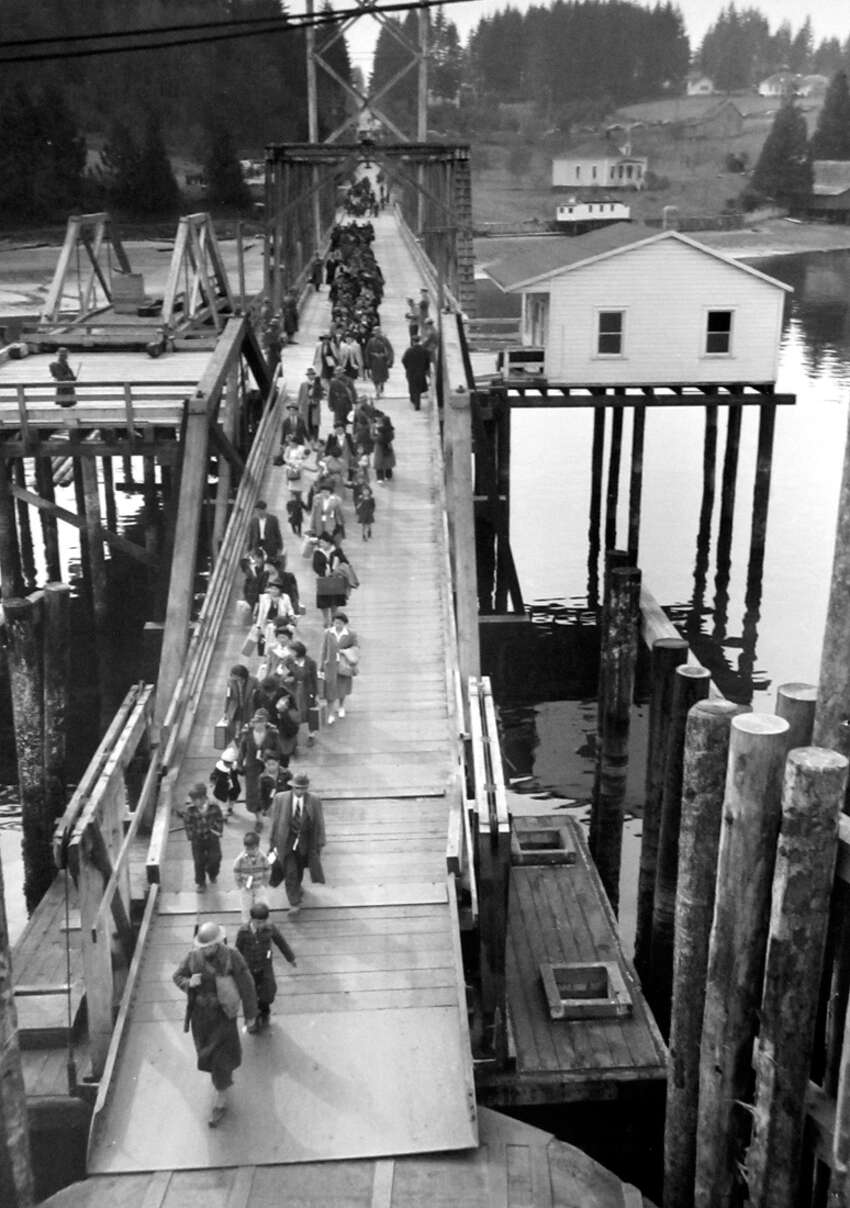 This picture was taken in 1942 after Japanese Americans were taken to internment camps, as ordered in February of that year by President Franklin Roosevelt. The following month a P-I photographer followed 225 people were left Bainbridge Island for internment camps. A few of these images have never been published, and since 1976 the P-I negatives have been carefully preserved at the Museum of History and Industry.
