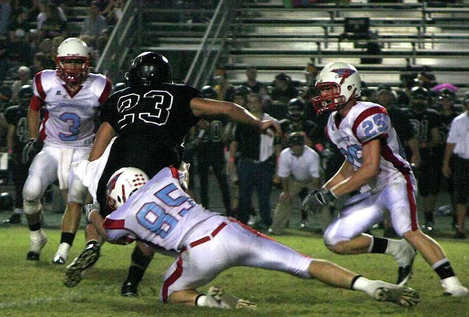 The Lumberton Raiders showed true sportsmanship and character as they lost to Vidor, 66-6 in Friday night's game. Raider Kelby Meyers makes a tackle as other Raiders approach to assist. Photo: David Lisenby, Freelance