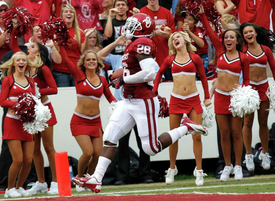 Oklahoma running back Alex Ross scores a touchdown during the first half. (AP Photo/LM Otero) Photo: LM Otero, Associated Press / AP