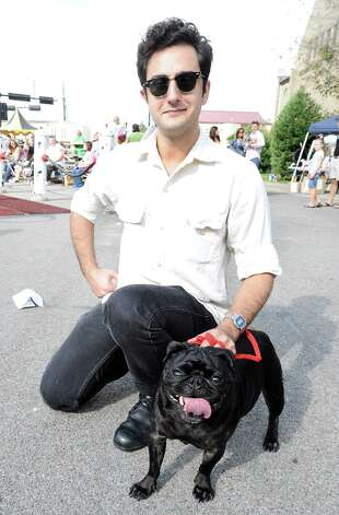 Carlo Busceme IV and Pepper enjoy their time at Dogtoberfest on Saturday, October 13, 2012 at the Giant Fire Hydrant at the Fire Museum in downtown Beaumont. Photo taken: Randy Edwards/The Enterprise Photo: Randy Edwards