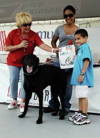 Eric Forse, 6, and Bishop takes home first place in the Paw-pictures competition at Dogtoberfest on Saturday, October 13, 2012 at the Giant Fire Hydrant at the Fire Museum in downtown Beaumont. Photo taken: Randy Edwards/The Enterprise Photo: Randy Edwards