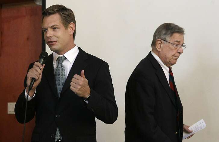 In this photo taken Sept. 7, 2012, California Rep. candidate Eric Swalwell speaks at left as Rep. Pete Stark, D-Calif. walks off the stage during an Alameda County Democratic Lawyers Club endorsement meeting at Everett & Jones Barbeque in Oakland, Calif. Pete Stark is used to coasting to re-election in the liberal enclave of the San Francisco Bay area he has represented since the end of the Vietnam War. Legislative gerrymandering kept him in a heavily Democratic district, and California's primary system virtually ensured that he would emerge to face Republican or fringe-party challengers with almost no chance of beating him in November. All that has changed this year, as Californians deal with two major political reforms that are remaking the congressional landscape and creating competitive races for the first time in many years. (AP Photo/Jeff Chiu)