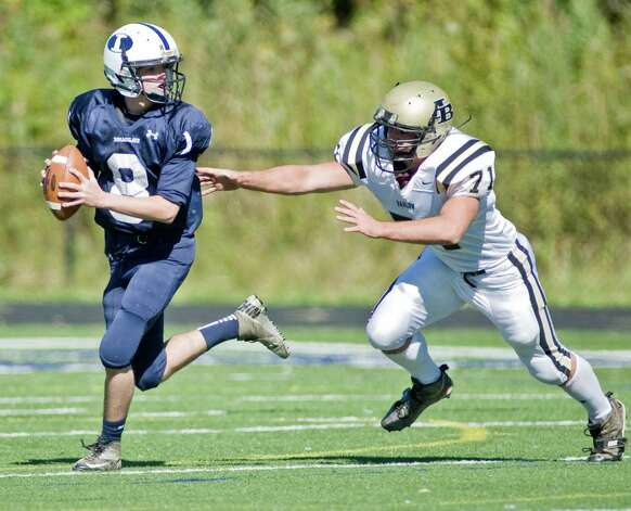 Immaculate High School quarterback Matthew Ryan tries to out run Joel Barlow High school's Christian Huribal in a game at Immaculate. Saturday, Oct. 13, 2012 Photo: Scott Mullin