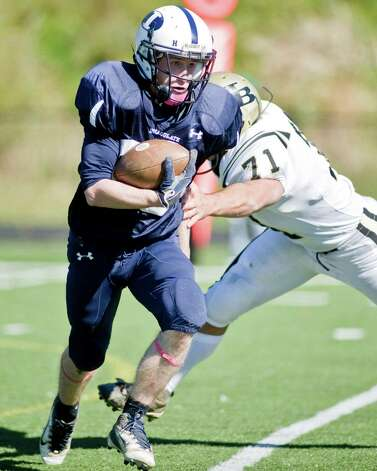 Immaculate High School running back Michael Woods carrying the ball against Joel Barlow High school in a game at Immaculate. Saturday, Oct. 13, 2012 Photo: Scott Mullin / The News-Times Freelance