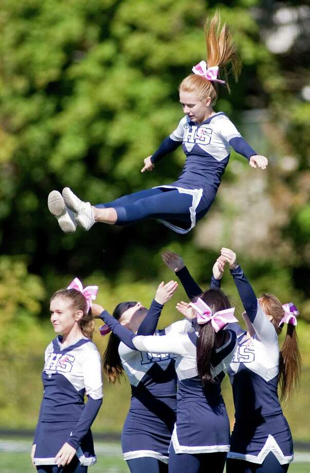 Immaculate High School cheerleaders performing at half-time during a football game against Joel Barlow High school, played at Immaculate. Saturday, Oct. 13, 2012 Photo: Scott Mullin / The News-Times Freelance