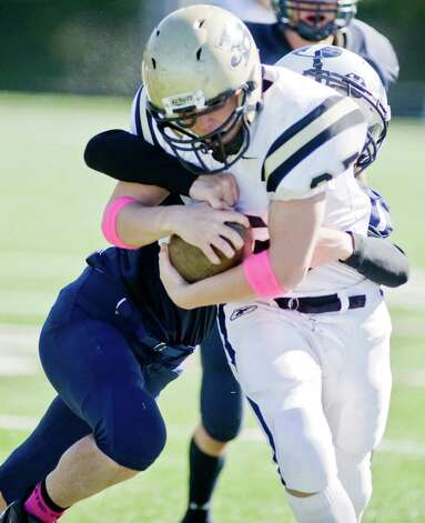 Joel Barlow High School's Scott Dineen secures the ball after a hit during a game against Immaculate High School, played at Immaculate. Saturday, Oct. 13, 2012 Photo: Scott Mullin / The News-Times Freelance