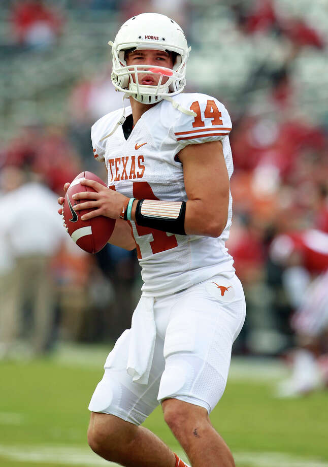 Longhorn quarterback David Ash gets in his pregame warm up as UT Oklahoma in the Red River Rivalry at the Cotton Bowl on October 13, 2012. Photo: Tom Reel, Express-News / ©2012 San Antono Express-News