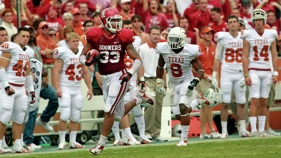 Trey Millard cruises down the Texas sideline after busting through two tacklers in the second quarter in the UT Oklahoma in the Red River Rivalry at the Cotton Bowl on October 13, 2012. Photo: Tom Reel, Express-News / ©2012 San Antono Express-News