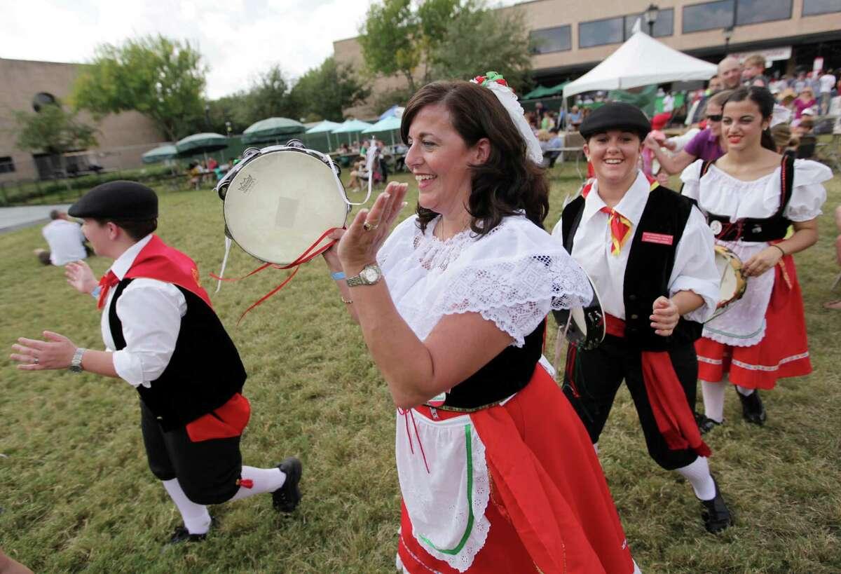 Mary Lofaro and the Italian Tarantellas, Italian folk dancers, perform during the 34th Houston Italian Festival at University of St. Thomas on Saturday, Oct. 13, 2012.
