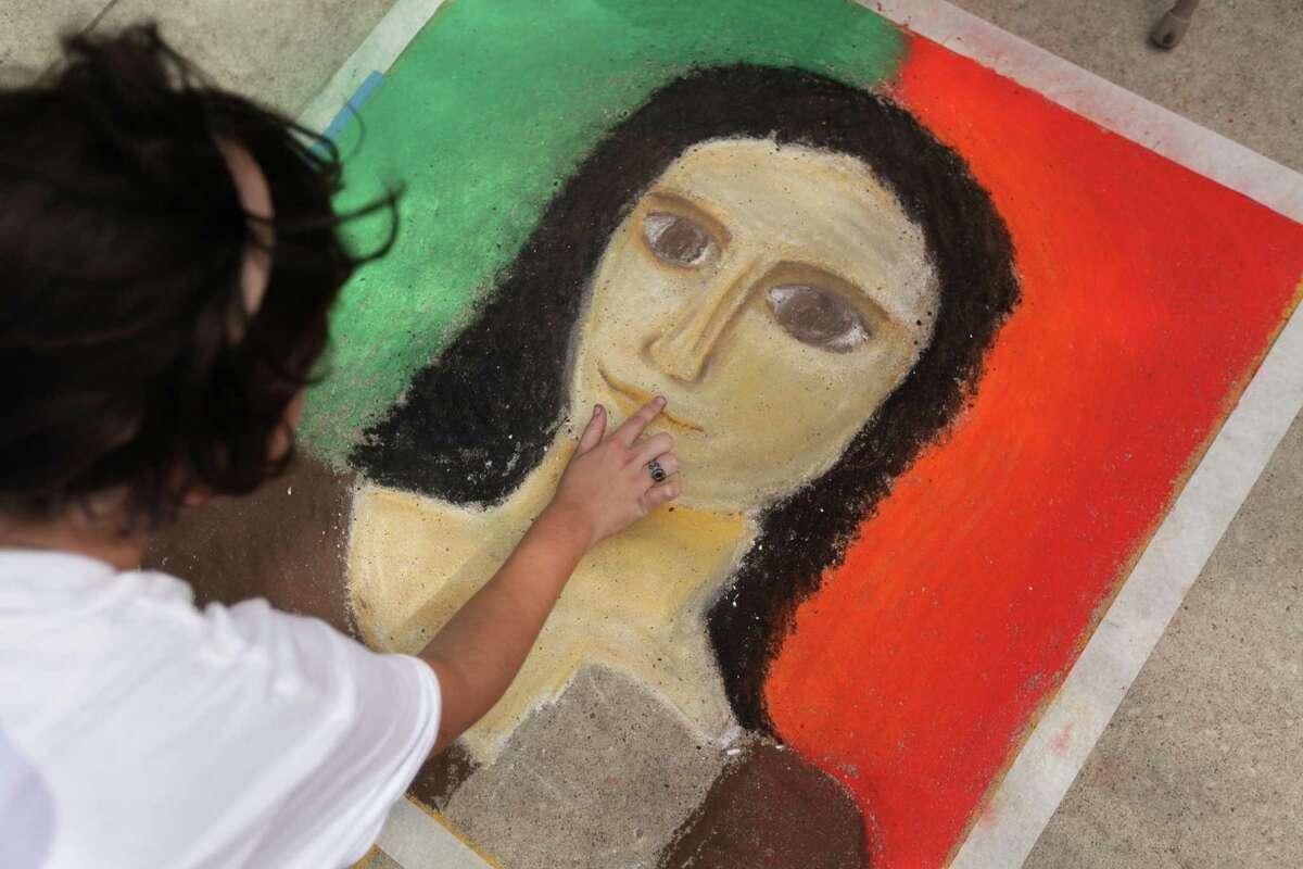 Abigail Bacilla, 17, of Incarnate Word Academy, participates in the Chalk Art contest by sketching Leonardo da Vinci-inspired portraits during the Houston Italian Festival.