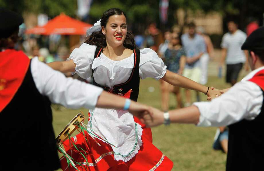 Melanie Lofaro, 18, dances with Italian Tarantellas, Italian Folk Dancing, during the 34th Houston Italian Festival at University of St. Thomas on Saturday, Oct. 13, 2012, in Houston. The Italian Tarantellas, Italian Folk Dancing, will perform Sunday at 12:30 p.m. The festival is sponsored by the Italian Cultural & Community Center (ICCC). Photo: Mayra Beltran, Houston Chronicle / © 2012 Houston Chronicle