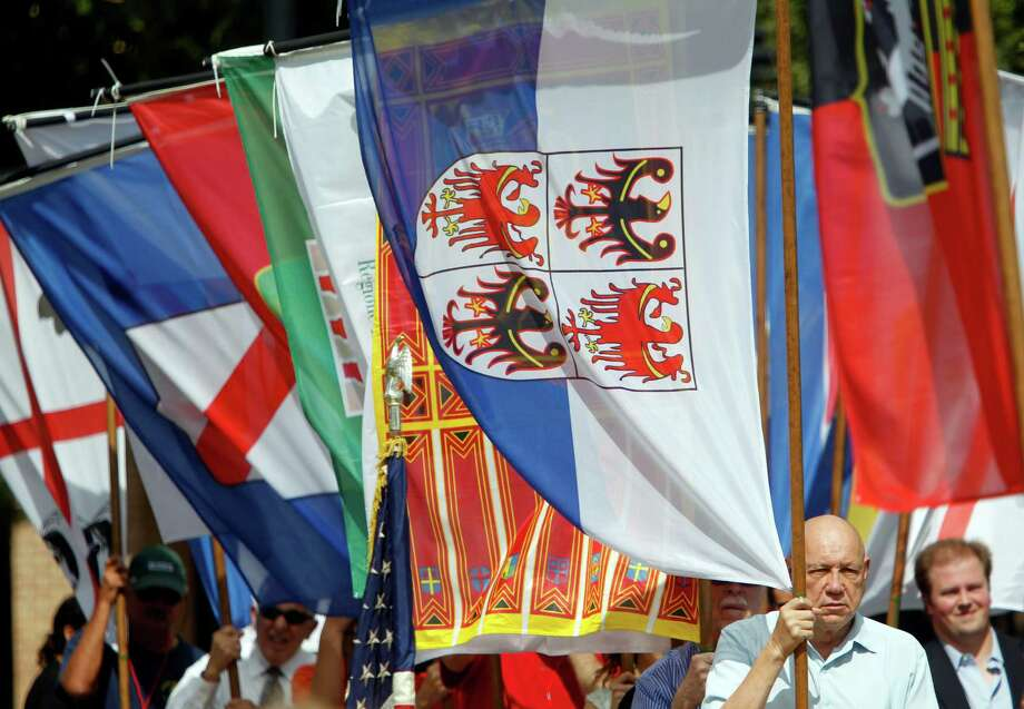 Ray DeVido carries the Tretino Alto Adige regional flag during the Flag Ceremony & Awards in the beginning of the 34th Houston Italian Festival at University of St. Thomas on Saturday, Oct. 13, 2012, in Houston. Festival sponsored by the Italian Cultural & Community Center (ICCC), and it runs until Sunday. Photo: Mayra Beltran, Houston Chronicle / © 2012 Houston Chronicle