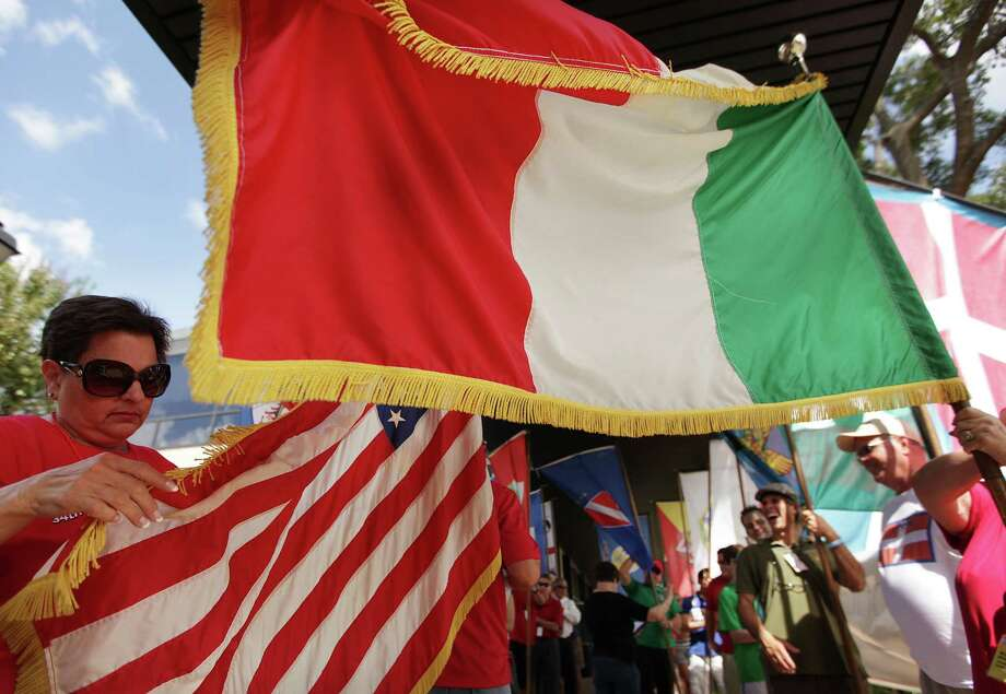 (Left) Gerry Barone, awarded ICCC Volunteer of the Year, carries the U.S. Flag during the Flag Ceremony & Awards to kick start the 34th Houston Italian Festival at University of St. Thomas on Saturday, Oct. 13, 2012, in Houston. Festival sponsored by the Italian Cultural & Community Center (ICCC), and it runs until Sunday. Photo: Mayra Beltran, Houston Chronicle / © 2012 Houston Chronicle