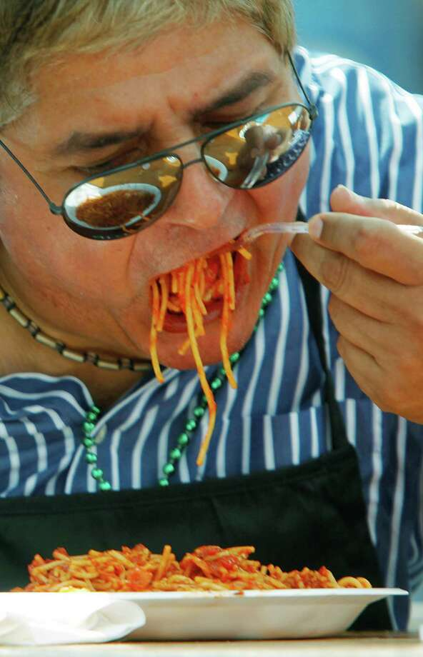 Eric Chapa participates in the Pasta Eating Contest during the 34th Houston Italian Festival at University of St. Thomas on Saturday, Oct. 13, 2012, in Houston. Festival sponsored by the Italian Cultural & Community Center (ICCC), and the Pasta Eating Contest is scheduled for 1 p.m on Sunday. Photo: Mayra Beltran, Houston Chronicle / © 2012 Houston Chronicle