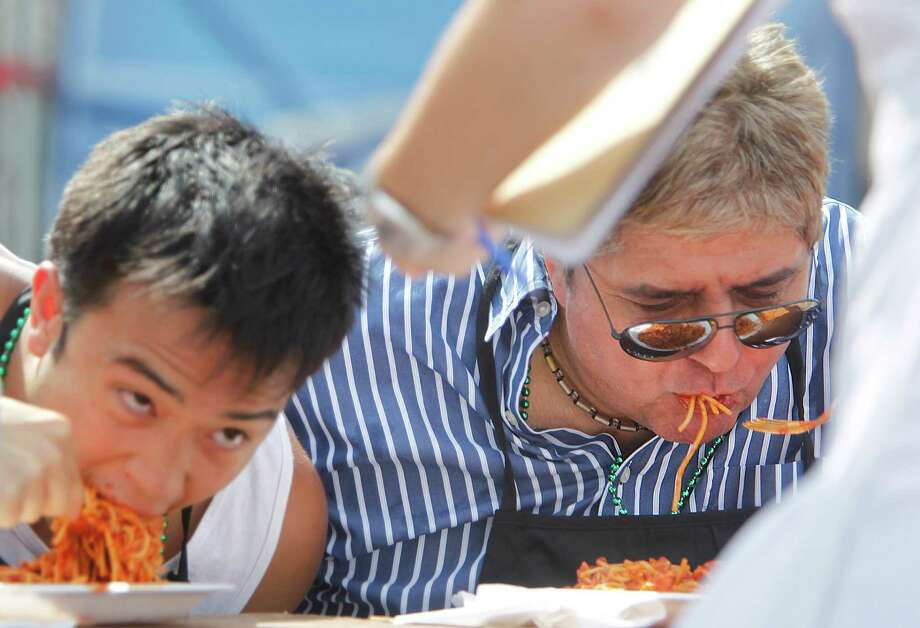 Andrew Alguyen and Eric Chapa participate in the Pasta Eating Contest during the 34th Houston Italian Festival at University of St. Thomas on Saturday, Oct. 13, 2012, in Houston. Festival sponsored by the Italian Cultural & Community Center (ICCC), and the Pasta Eating Contest is scheduled for 1 p.m on Sunday. Photo: Mayra Beltran, Houston Chronicle / © 2012 Houston Chronicle