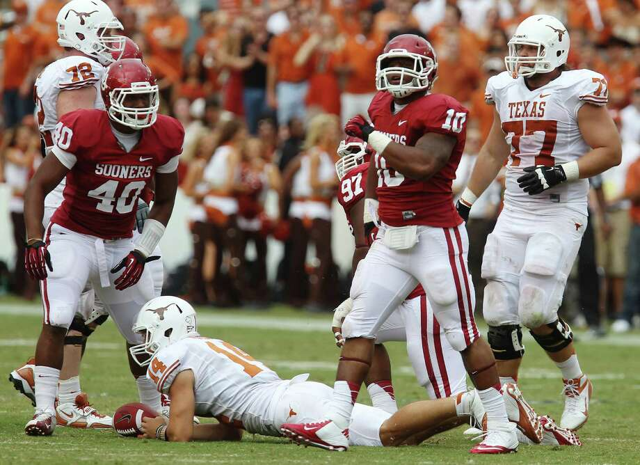 Oklahoma Sooners' Rashod Favors (10) reacts after a tackle on Texas Longhorns quarterback David Ash in the second half at the Red River Rivalry at the Cotton Bowl in Dallas on Saturday, Oct. 13, 2012. The Sooners defeated the Longhorns 63-21. Photo: Kin Man Hui, Express-News / © 2012 San Antonio Express-News