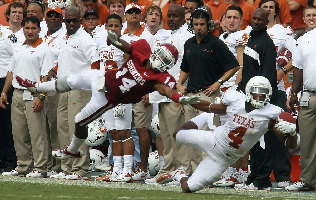 Texas Longhorns' Cayleb Jones (04) attempts to make a catch against Oklahoma Sooners' Aaron Colvin (14) in the second half at the Red River Rivalry at the Cotton Bowl in Dallas on Saturday, Oct. 13, 2012. The Sooners defeated the Longhorns 63-21.
