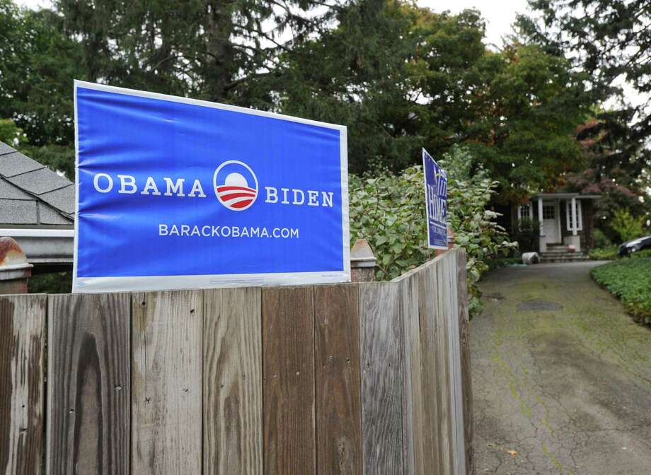 "An ""Obama/Biden"" sign attached to the top of a wooden fence of a Byram home, Friday, Oct. 12, 2012. Photo: Bob Luckey / Greenwich Time"