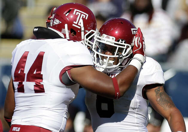 Temple running back Montel Harris (8) celebrates his touchdown with teammate Wyatt Benson (44) in the first quarter of an NCAA college football game in East Hartford, Conn., Saturday, Oct. 13, 2012. (AP Photo/Michael Dwyer) Photo: Michael Dwyer, Associated Press / AP