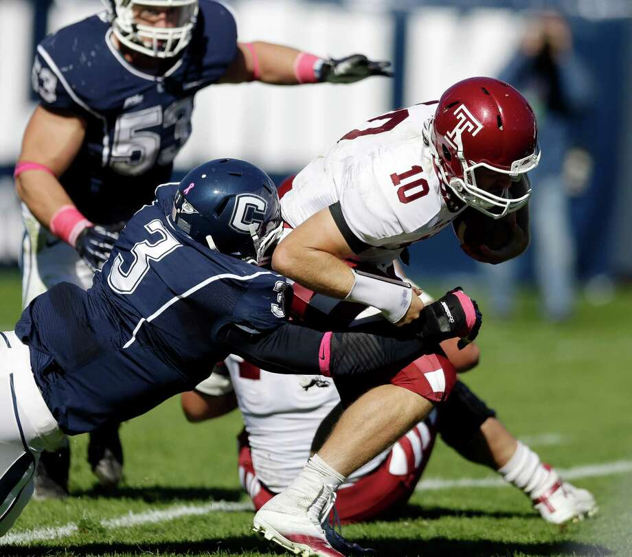 Connecticut linebacker Sio Moore (3) sacks Temple quarterback Chris Coyer (10) in the first quarter of an NCAA football game in East Hartford, Conn., Saturday, Oct. 13, 2012. (AP Photo/Michael Dwyer) Photo: Michael Dwyer, Associated Press / AP