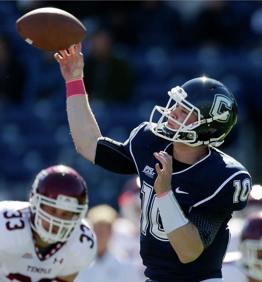 Connecticut quarterback Chandler Whitmer (10) passes in the first quarter of an NCAA football game against Temple in East Hartford, Conn., Saturday, Oct. 13, 2012. (AP Photo/Michael Dwyer) Photo: Michael Dwyer, Associated Press / AP