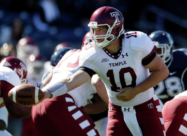 Temple quarterback Chris Coyer (10) hands off in the first quarter of an NCAA football game against Connecticut in East Hartford, Conn., Saturday, Oct. 13, 2012. (AP Photo/Michael Dwyer) Photo: Michael Dwyer, Associated Press / AP