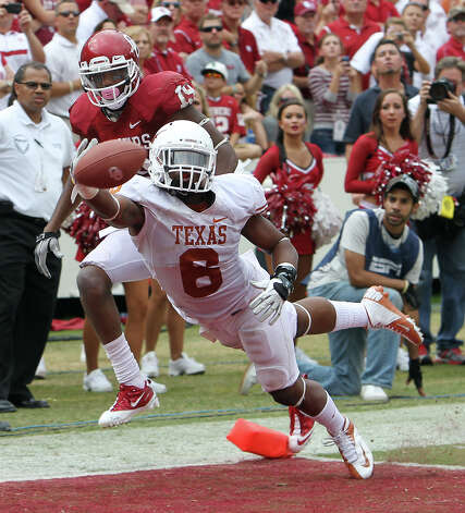 Texas Longhorns' Quandre Diggs (06) deflects a pass from Oklahoma Sooners' Justin Brown (19) in the second half at the Red River Rivalry at the Cotton Bowl in Dallas on Saturday, Oct. 13, 2012. The Sooners defeated the Longhorns 63-21. Photo: Kin Man Hui, Express-News / © 2012 San Antonio Express-News