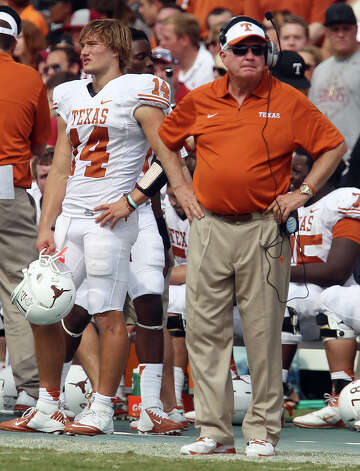 Texas Longhorns head coach Mac Brown (right) and quarterback David Ash (left) had difficulty finding a solution against the Oklahoma Sooners in the second half at the Red River Rivalry at the Cotton Bowl in Dallas on Saturday, Oct. 13, 2012. The Sooners defeated the Longhorns 63-21. Photo: Kin Man Hui, Express-News / © 2012 San Antonio Express-News