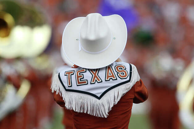 The Texas Longhorn Marching Band takes the field at the Red River Rivalry at the Cotton Bowl in Dallas on Saturday, Oct. 13, 2012. Photo: Kin Man Hui, Express-News / © 2012 San Antonio Express-News
