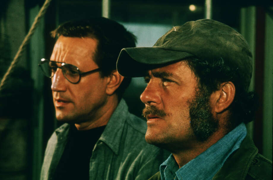 30. Jaws (1975): Most horror movies take place at night in claustrophobic settings. Not this summer blockbuster. It was a primal, sun-soaked, open-water thriller featuring an impressive man-eating monster (besides Robert Shaw's sideburns).  Photo: Universal Studios