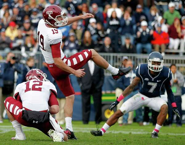 Temple punter Brandon McManus (19) watches his game-winning field goal between teammate Connor Reilly (12) and Connecticut cornerback Dwayne Gratz (7) in overtime during an NCAA college football game in East Hartford, Conn., Saturday, Oct. 13, 2012. Temple won 17-14. (AP Photo/Michael Dwyer) Photo: Michael Dwyer, Associated Press / AP