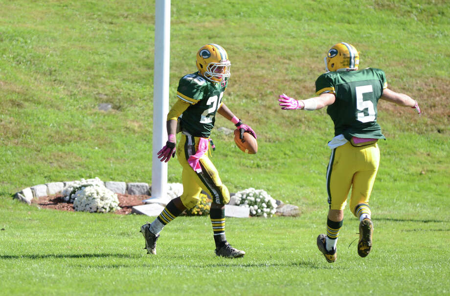 Trinity's Randy Polonia (28) celebrates a touchdown with teammate Cody Zaro (5) during the football game against Stamford at Trinity Catholic High School in Stamford on Saturday, Oct. 13, 2012. Photo: Amy Mortensen / Connecticut Post Freelance