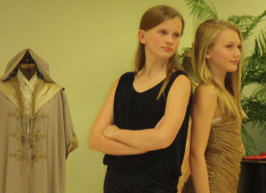 "Two young women model fashions Friday night at the ""Dressing Up -- Westport Style"" program sponsored by the Westport Woman's Club and Westport Historical Society. Photo: Meg Barone / Westport News freelance"