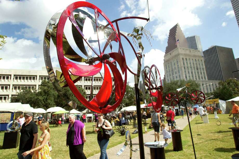 Amos Robinson's kinetic art rises above the visitors to the Bayou City Art Festival Saturday, Oct. 13, 2012, in Houston. Photo: Brett Coomer, Houston Chronicle / © 2012 Houston Chronicle