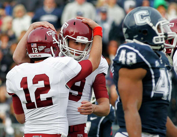 Temple place kicker Brandon McManus, center, celebrates his game-winning field goal with teammate Connor Reilly (12) as Connecticut defensive end Trevardo Williams (48) walks away in overtime during an NCAA football game in East Hartford, Conn., Saturday, Oct. 13, 2012. Temple won 17-14. (AP Photo/Michael Dwyer) Photo: Michael Dwyer, Associated Press / AP