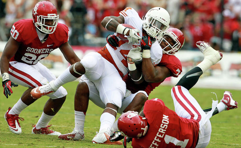 Joe Bergeron is stopped on the right as he tries a run in the first half as UT plays Oklahoma in the Red River Rivalry at the Cotton Bowl on October 13, 2012. Photo: Tom Reel, Express-News / ©2012 San Antono Express-News