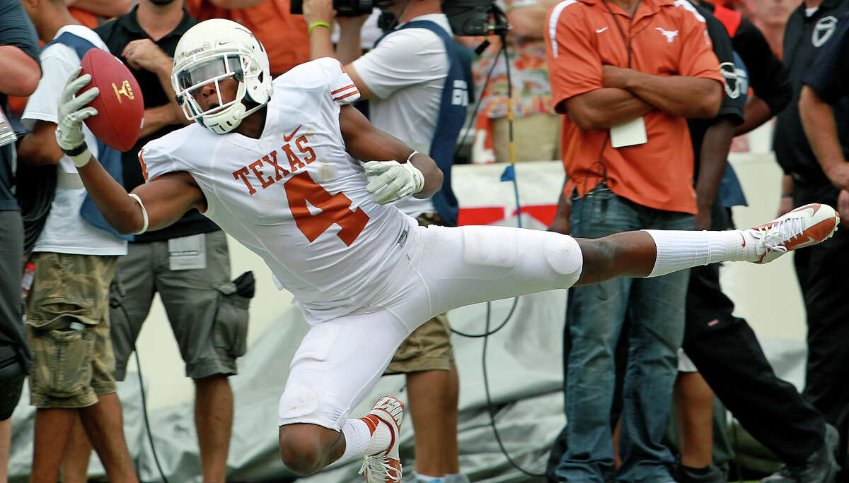 Cayleb Jones one hands a catch for the Longhorns but comes down with it out of bounds as UT plays Oklahoma in the Red River Rivalry at the Cotton Bowl on October 13, 2012.