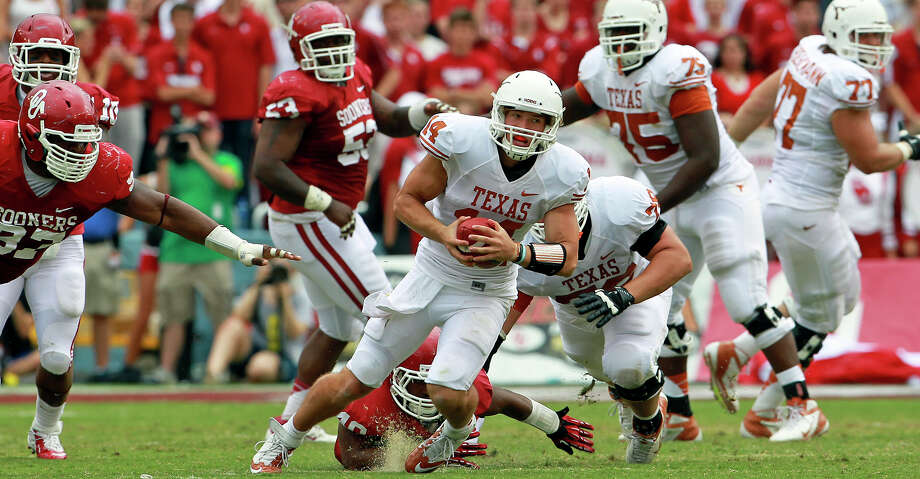 Loonghorn quarterback David Ash scampers away from pressure in the second half as UT plays Oklahoma in the Red River Rivalry at the Cotton Bowl on October 13, 2012. Photo: Tom Reel, Express-News / ©2012 San Antono Express-News