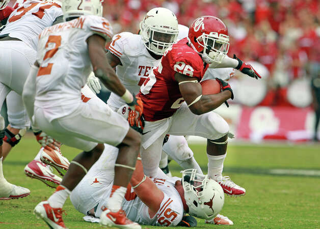 Sooner running back Alex Ross runs over Texas defenders in the second hald as UT plays Oklahoma in the Red River Rivalry at the Cotton Bowl on October 13, 2012. Photo: Tom Reel, Express-News / ©2012 San Antono Express-News