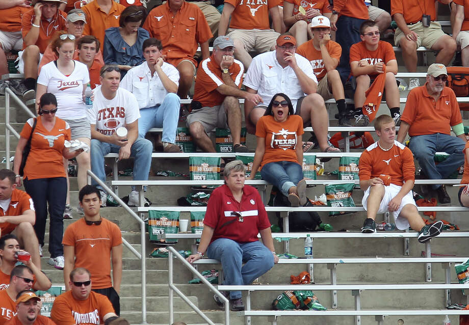 Texas Longhorns fans were taken completely out of the game as the Oklahoma Sooners defeated the Texas Longhorns 63-21 at the Red River Rivalry at the Cotton Bowl in Dallas on Saturday, Oct. 13, 2012. Photo: Kin Man Hui, Express-News / © 2012 San Antonio Express-News