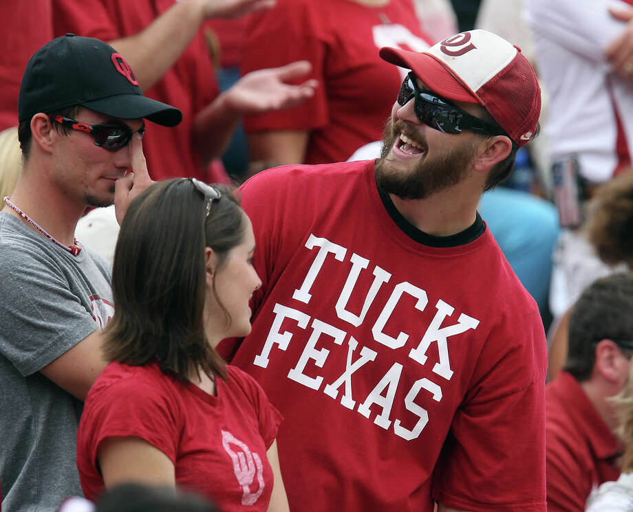 An Oklahoma Sooners fan wears his sentiments on his tee shirt during the Texas Longhorns game the Oklahoma Sooners at the Red River Rivalry at the Cotton Bowl in Dallas on Saturday, Oct. 13, 2012. Photo: Kin Man Hui, Express-News / © 2012 San Antonio Express-News