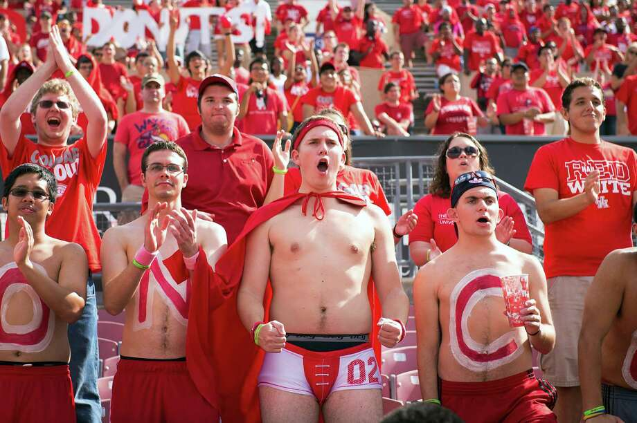 Houston fans cheer the opening kickoff of a college football game against UAB at Robertson Stadium, Saturday, Oct. 13, 2012, in Houston. Photo: Smiley N. Pool, Houston Chronicle / © 2012  Houston Chronicle
